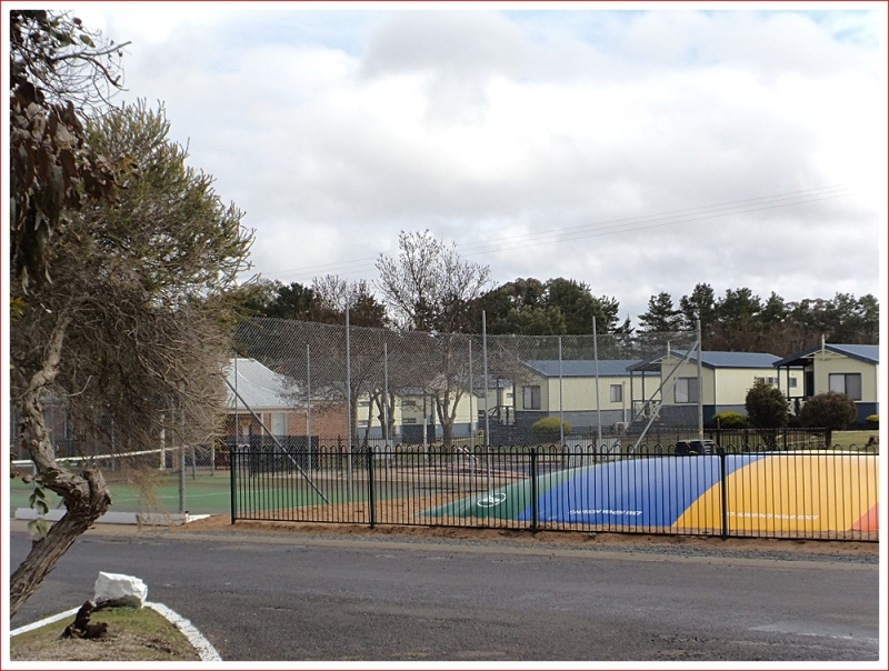 Jumping pillow, tennis court, swimming pool and cabins at Capital Country Holiday Park