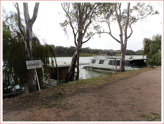 Houseboats along the river bank.