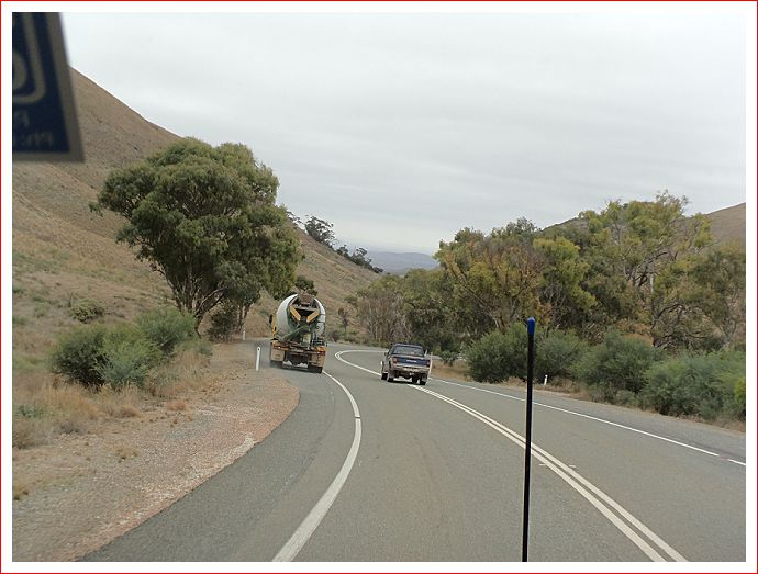 Would you overtake the concrete truck over double lines and on a bend, going downhill?